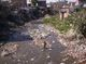 Thumb_slum_and_dirty_river